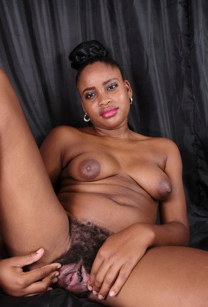 Black first timer with long legs spreads her naturally hairy pussy lips