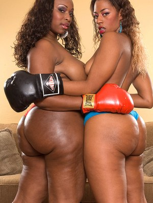 2 black females show off their big booties wearing lingerie and boxing gloves