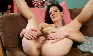 Hairy older woman Sunshine open her legs for butthole and beaver viewing