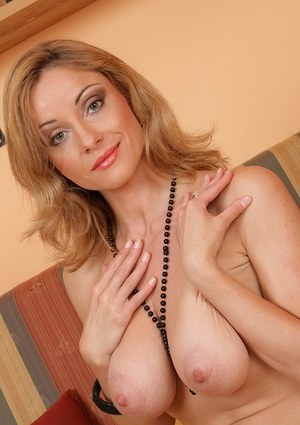 Sexy MILF Wanda removes her summer dress and delves fingers into pussy