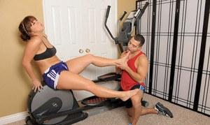 Amateur female Alice Bell gives her guy a footjob after aerobic workout