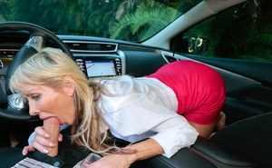 Cheerful MILF shows pussy upskirt in a car and gives a footjob and a hot blow