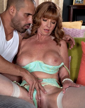 Mature vixen with big tits Dee Delmar gets her boobs squeezed and twat screwed