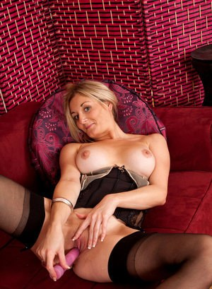 Mature chick Scarlet boasts of her gorgeous body curves and toys pussy on cam