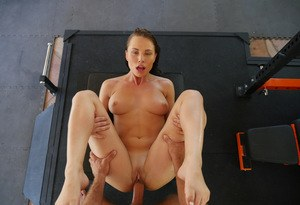Voluptuous pornstar with a sporty body takes a ride on a stiff dick in the gym