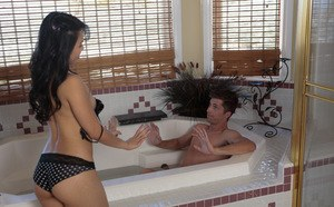Playful Asian siren with a gorgeous ass jerks off cock in the bathroom