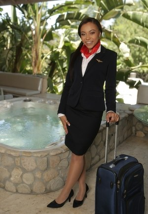 Black stewardess Nicole Bexley poses for nude outdoor photos on the side
