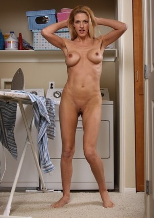 MILF with astonishing tight body and fake boobs Roxanne Hall shows her nudity