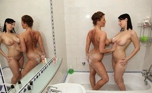 Kinky European lesbians Chrissy and Amy Wild have soapy sex in the bathroom