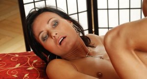 European brunette Paola masturbates her bald pussy with a glass dildo