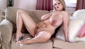 Kelly Kay removes her lingerie to pose her big tits and pussy in hot details