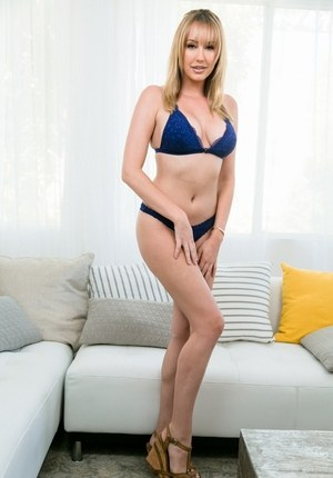 Stunning Brett Rossi reveals her big tits in a quality solo play