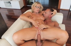 European MILF in glasses Marina Beaulieu gets her mouth and pussy screwed