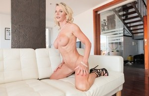 Blonde MILF Marina Beaulieu removes white lingerie for nude posing
