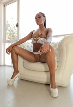 Hot black model Noe Milk displays her sexy oil covered ass in high heel shoes
