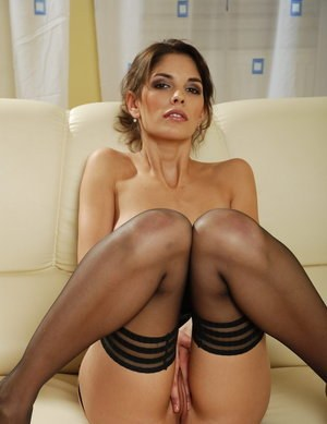Hot female in sexy black stockings spreads her wet pussy lips open