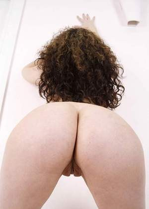 Chubby MILF Kiki Daire strips naked other than her glasses and high heels