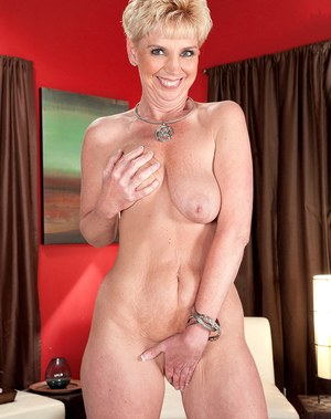 Cheerful mature bitch with short hair spreads legs to show her pink wet kitty