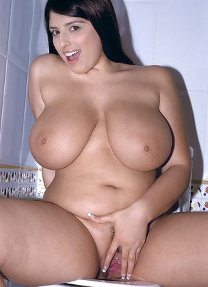 European brunette with huge tits shows off her chubby body and bouncing boobs