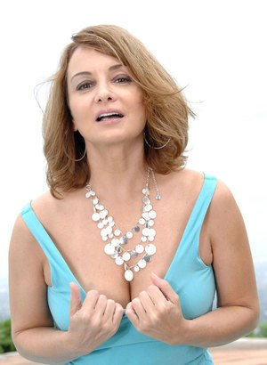 Mature lady Rebecca Bardoux bares her tits before playing with her pussy