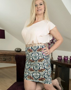 Mature blonde Marina Rene reveals her big tits and her awesome pierced pussy