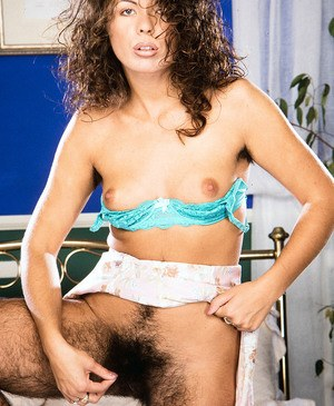 Hairy amateur slut reveals her awesome bushes on cunt and all over her body