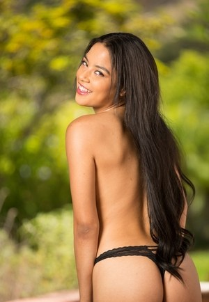 Smiling Latina girl Maya Bijou takes off clothes outdoors to show her nudity