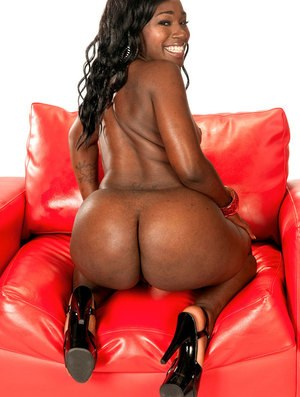 Ebony sex doll with a big chocolate ass Coco Isis toys her pussy in closeup
