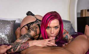 Red-haired cougar Anna Bell Peaks with a lean tattooed body gives dick riding