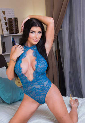 Brunette wife with a gorgeous booty Romi Rain exposes her ass and bubble tits