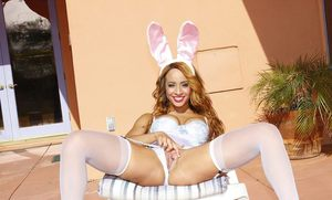 Cheerful ebony chick Teanna Trump enjoys playing a cosplay solo outdoors