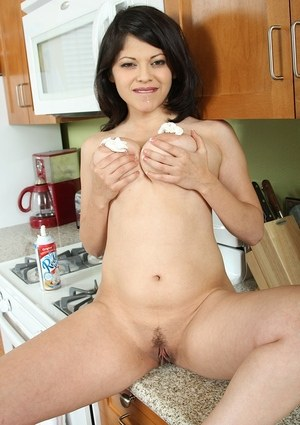 Latina MILF Evie Delatosso covers her big natural tits with whip cream