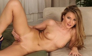 Fascinating blonde MILF Angel Snow undresses on cam to pose completely naked