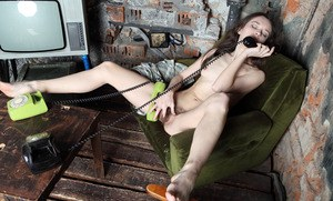 Older solo model plays with her beaver while having phone sex