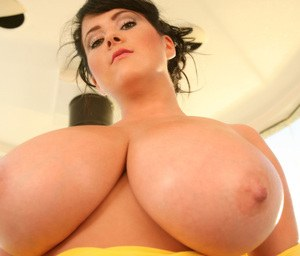Hot buxom woman Rachel Aldana takes off her blouse and exposes her huge melons