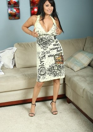 Busty Latina MILF Sophia Lomeli spreads her bare legs after undressing