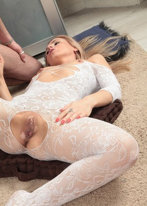 Mature woman gives oral sex favours on her knees in crotchless bodystocking