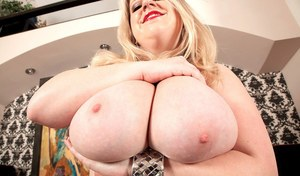 Cheerful BBW chick Janne Hollan takes off her red clothes shows awesome curves