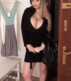 Buxom blonde hottie Micky Bells is happy to demosntrate her fat tits and pussy