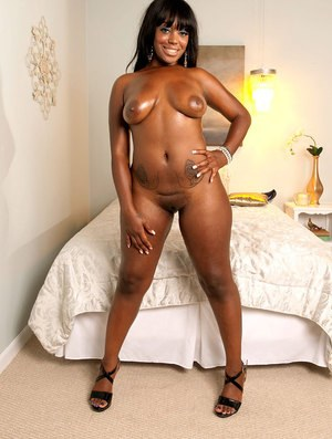 Black solo model Aaliyah Envy oils up her big booty after lingerie removal