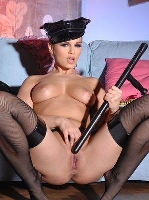 Eve Angel works the police bat in her shaved twat while posing in hot uniform
