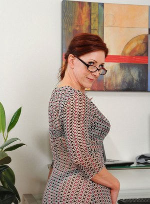 Mature with glasses shows off her slutty side while alone in the office