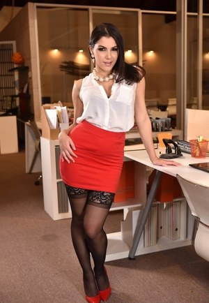 Elegant hottie in a red miniskirt Valentina Nappi strips and plays a solo