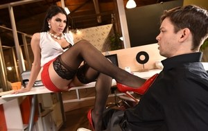 European brunette Valentina Nappi gives a footjob and rides cock in the office