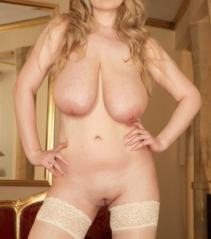 BBW blonde MILF with huge boobs Micky Bells shows off her gorgeous assets