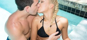 Young blonde with hair in braided pigtails fucks her guy's big dick in pool