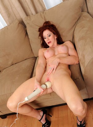 Voluptuous mature redhead Catherine Desade stimulates pussy with a vibrator