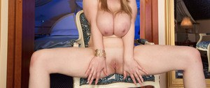 Tall blonde MILF Micky Bells licks her nipples and spreads legs wide apart