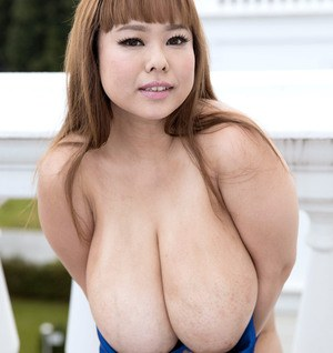 Buxom asian beauty P-Chan plays with her huge awesome boobs and shows booty