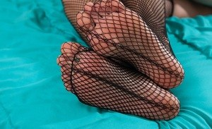 Mature bitch in fishnet stockings Alice Chambers toys her hungry pussy rough